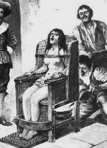 Witch Torture - naked on a chair with nails protruding and a fire set below