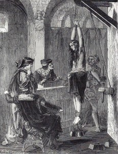 Interrogating a witch through torture - hanging by thumbs with weighted ankles